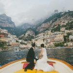 Couple looking at city from boat