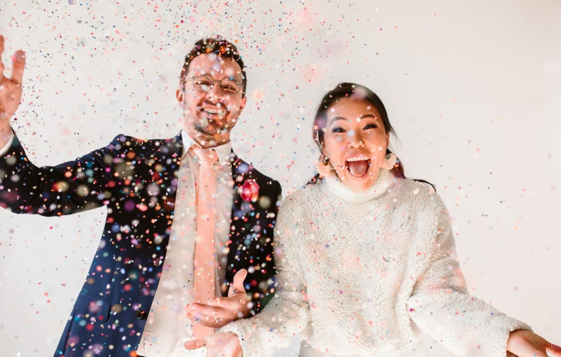 Couple throwing confetti