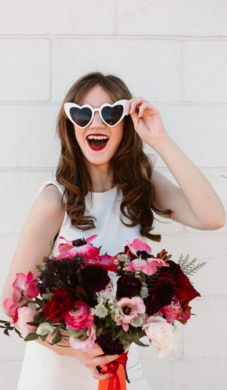 Bride smiling with glasses on
