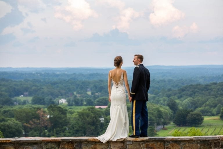 View of an elopement ceremony option from the stone wall at The Stable at Bluemont Vineyard with the view of the Loudoun Valley as the backdrop.