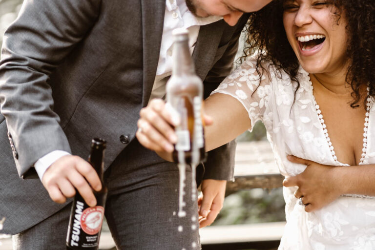 Couple celebrates their elopement by cracking open a beer