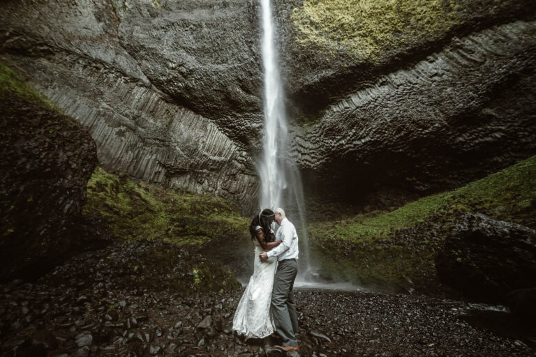 Couple Elopes at the Base of a Waterfall