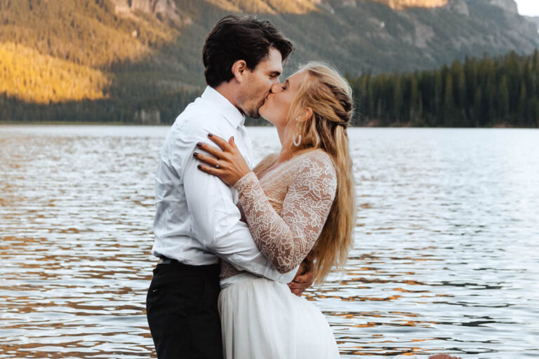 Couple Kisses in Montana Lake After Exchanging Vows