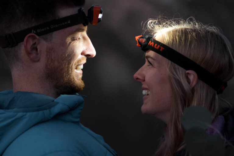 Eloping couple with headlamps during their sunrise elopement