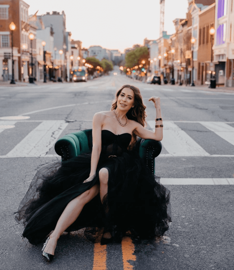 Woman on chair in the middle of a street
